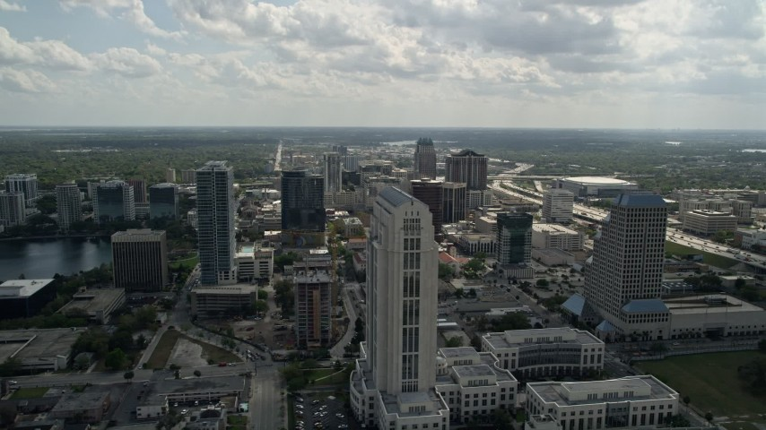 5K stock footage aerial video flyby courthouse, office tower and freeway in Downtown Orlando, Florida Aerial Stock Footage   AX0035_004E