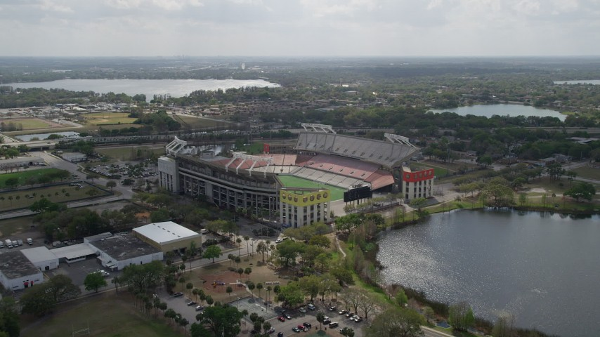 5K stock footage aerial video of approaching Lake Lorna Doone and Citrus Bowl football stadium, Orlando, Florida Aerial Stock Footage | AX0035_007