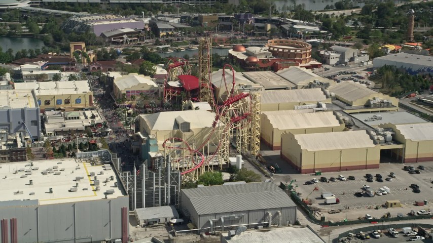 5K stock footage aerial video of a roller coaster at Universal Studios Florida, Orlando, Florida Aerial Stock Footage | AX0035_016