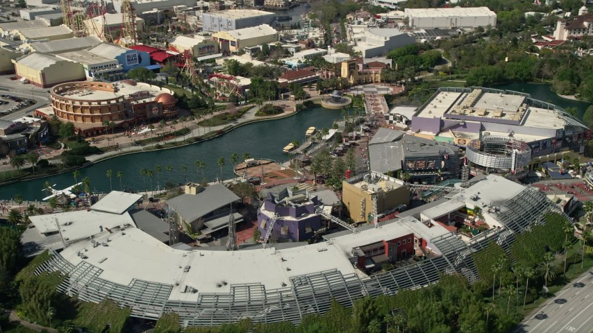 5K stock footage aerial video of the City Walk at Universal Studios theme park in Orlando, Florida Aerial Stock Footage | AX0035_022