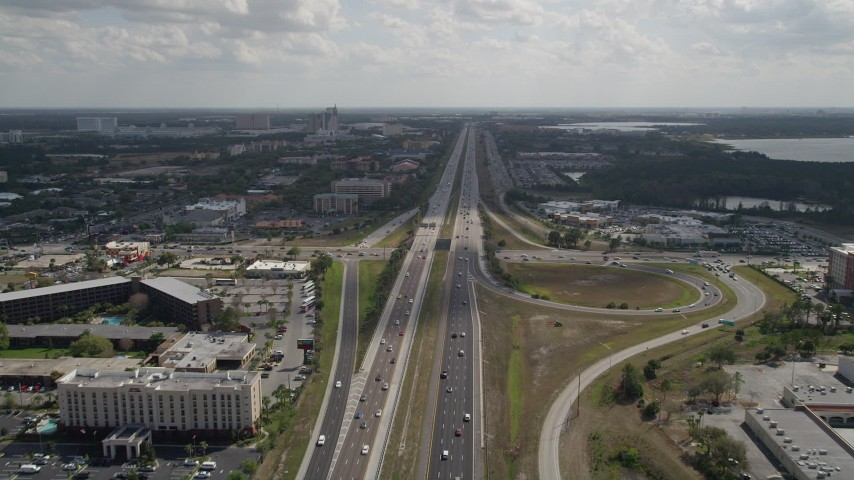 5K stock footage aerial video of following an interstate with medium traffic, Orlando, Florida Aerial Stock Footage | AX0035_027