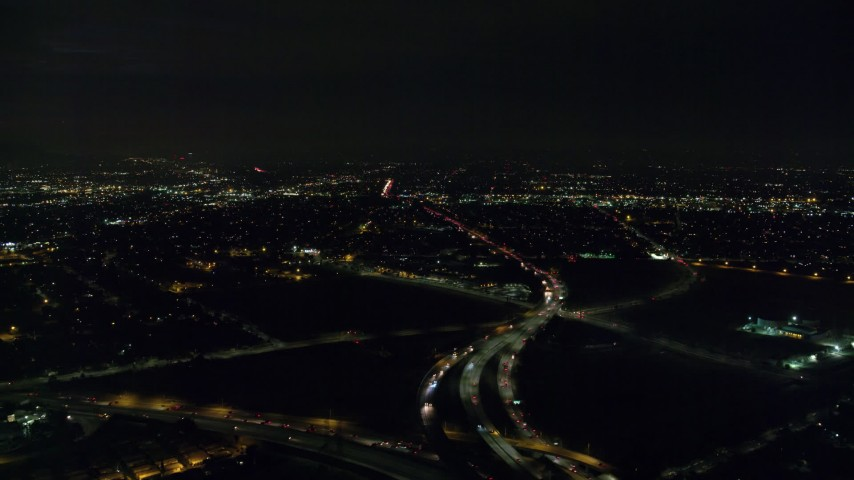 8K stock footage aerial video approaching the 5 and 170 freeway split at  night in Pacoima, California