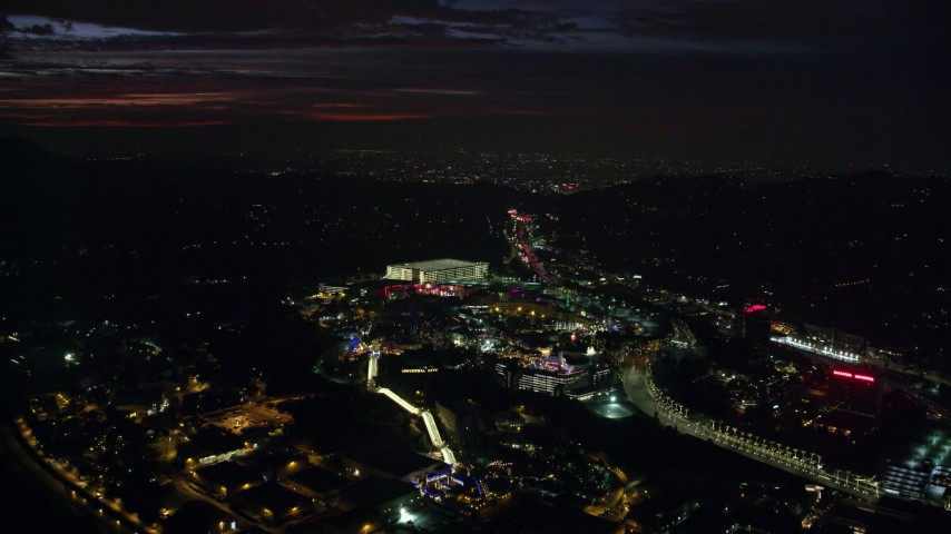 8K stock footage aerial video of Universal Studios Hollywood in Universal City at night in California Aerial Stock Footage | AX0156_005