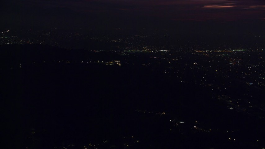 8K stock footage aerial video of a view of the Griffith Observatory in the hills at night in Los Angeles, California Aerial Stock Footage | AX0156_007
