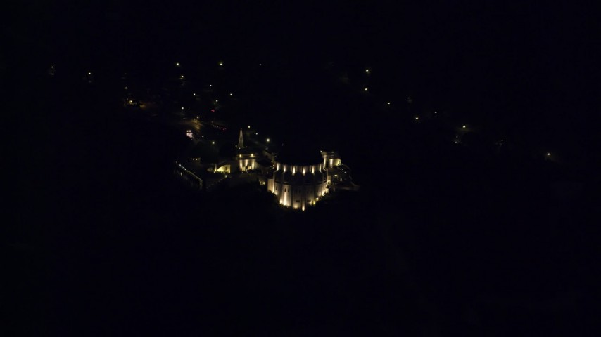 8K stock footage aerial video flying by the Griffith Observatory in the hills at night in Los Angeles, California Aerial Stock Footage | AX0156_009