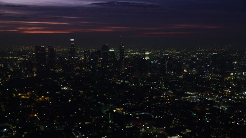 8K stock footage aerial video of Downtown Los Angeles skyscrapers at sunrise, California Aerial Stock Footage AX0156_021 | Axiom Images
