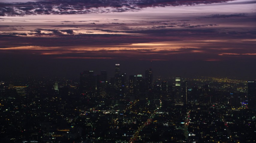 8K aerial video of clouds over tall Downtown Los Angeles skyscrapers at sunrise, California Aerial Stock Footage | AX0156_025