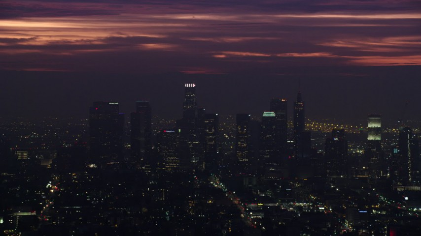 8K aerial video of tall Downtown Los Angeles skyscrapers at sunrise, California Aerial Stock Footage | AX0156_026