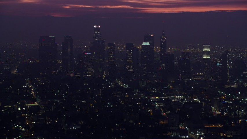 8K stock footage aerial video of towering Downtown Los Angeles skyscrapers at sunrise, California Aerial Stock Footage | AX0156_027