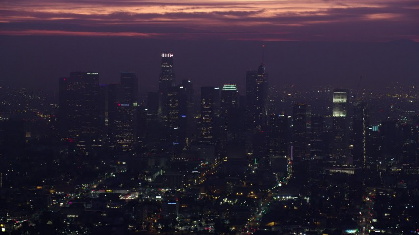 8K aerial video of towering Downtown Los Angeles high-rises at sunrise, California Aerial Stock Footage | AX0156_028