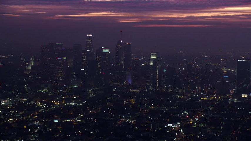 8K aerial video flying by Downtown Los Angeles high-rises at sunrise, California Aerial Stock Footage | AX0156_029