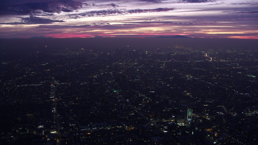 8K stock footage aerial video of a wide view of Downtown Los Angeles skyscrapers at sunrise, California Aerial Stock Footage AX0156_030 | Axiom Images