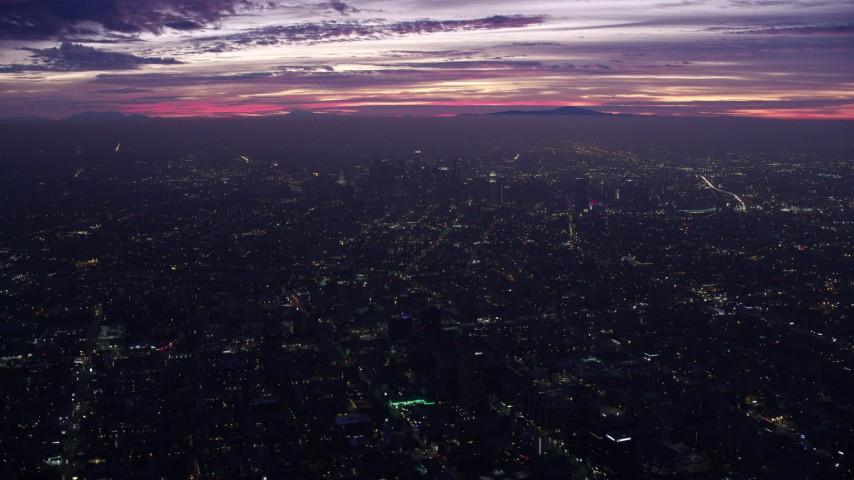 8K stock footage aerial video flying over the city to approach Downtown Los Angeles skyscrapers at sunrise, California Aerial Stock Footage | AX0156_032