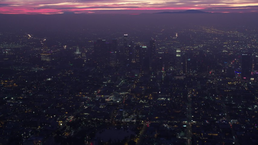 8K stock footage aerial video approaching Downtown Los Angeles skyscrapers at sunrise, California Aerial Stock Footage | AX0156_033