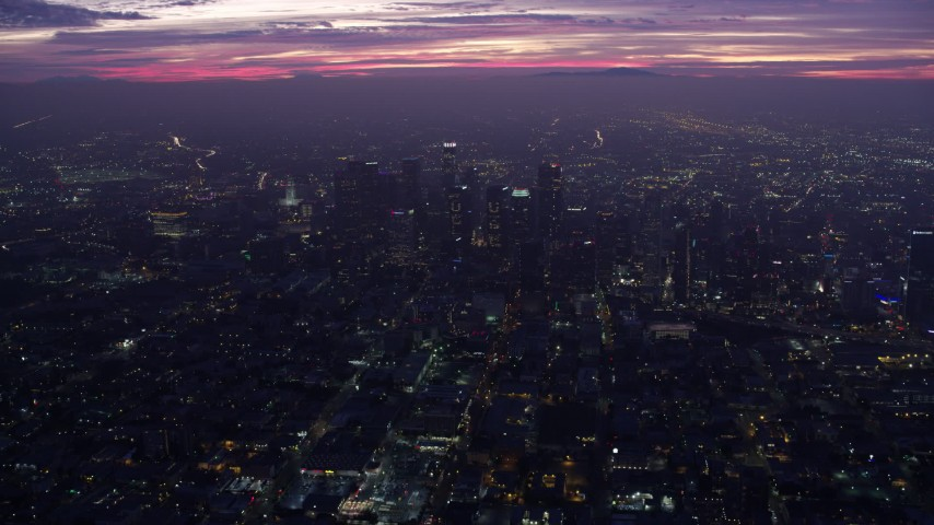 8K stock footage aerial video approaching to Downtown Los Angeles skyscrapers at sunrise, California Aerial Stock Footage | AX0156_034