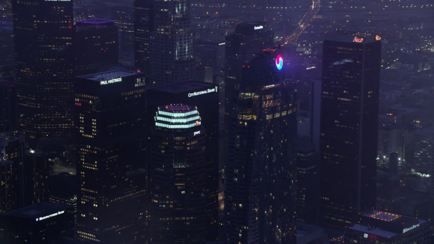 8K stock footage aerial video of a reverse view of Wilshire Grand Center in Downtown Los Angeles at sunrise, California Aerial Stock Footage AX0156_037 | Axiom Images