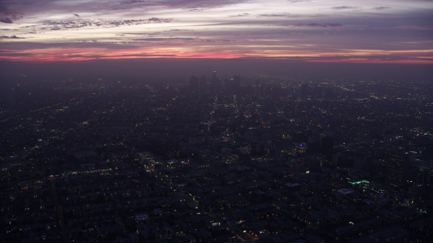 8K aerial video flying by and away from Downtown Los Angeles at sunrise, California Aerial Stock Footage | AX0156_040