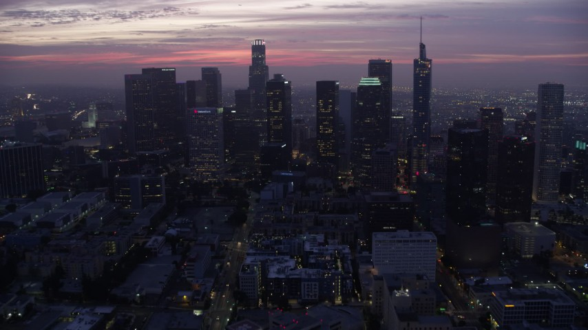 8K stock footage aerial video on approach to the Downtown Los Angeles skyline at sunrise, California Aerial Stock Footage AX0156_044 | Axiom Images