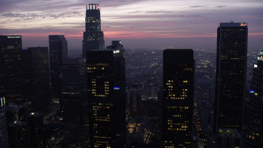 8K aerial video approaching and fly between skyscrapers in Downtown Los Angeles at sunrise, California Aerial Stock Footage AX0156_045