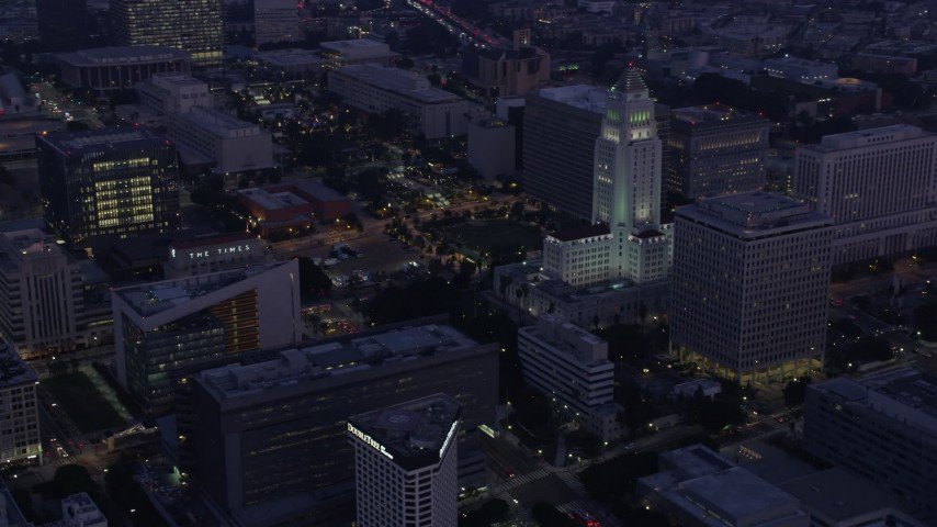 8K stock footage aerial video of City Hall and city government buildings in Downtown Los Angeles at sunrise, California Aerial Stock Footage | AX0156_046