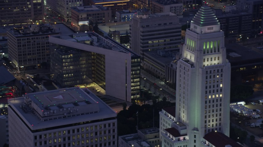 8K stock footage aerial video of LAPD Headquarters, LA Times Building, and City Hall in Downtown Los Angeles at sunrise, California Aerial Stock Footage | AX0156_047