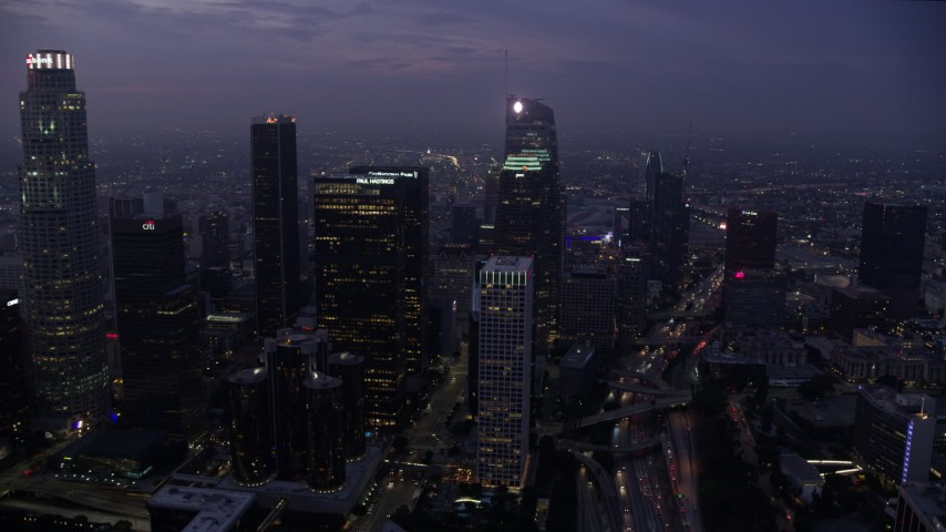 8K stock footage aerial video flying by Downtown Los Angeles skyscrapers to Wilshire Grand Center at sunrise, California Aerial Stock Footage | AX0156_048