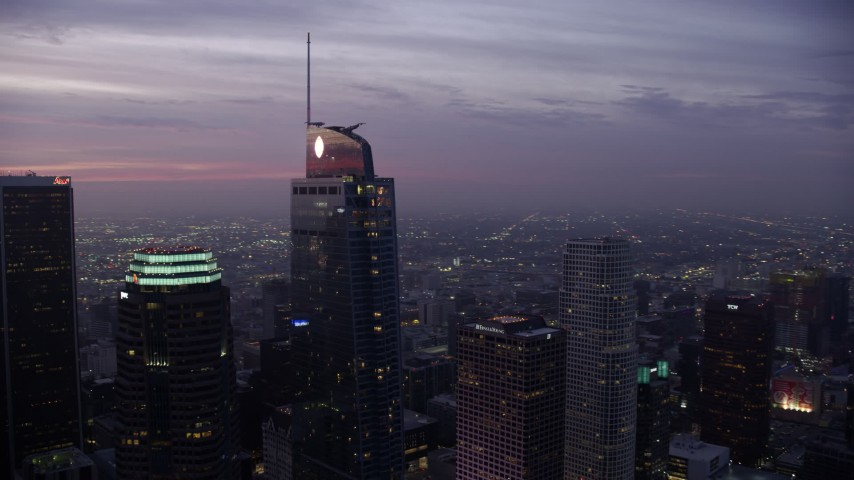 8K stock footage aerial video flying by the Wilshire Grand Center in Downtown Los Angeles at sunrise, California Aerial Stock Footage | AX0156_049