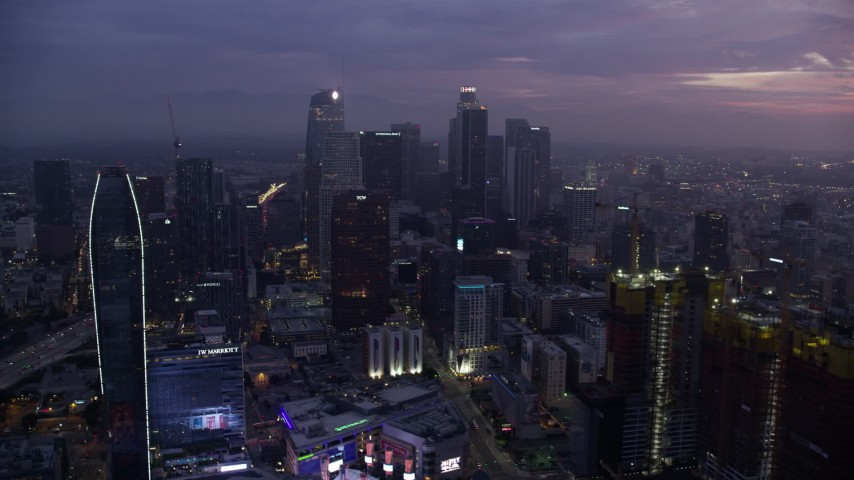 8K stock footage aerial video of the tall skyscrapers of Downtown Los Angeles at sunrise, California Aerial Stock Footage | AX0156_051