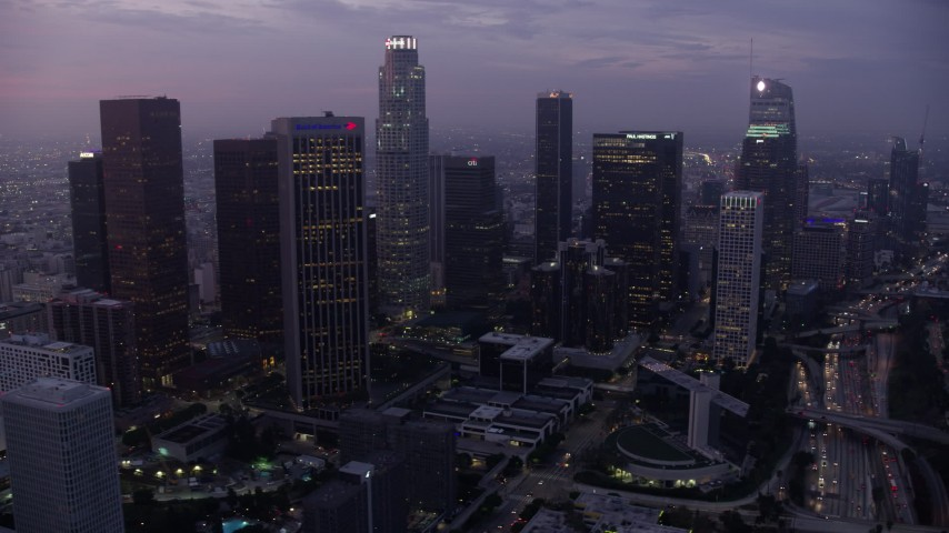 8K stock footage aerial video of a view of towering skyscrapers in Downtown Los Angeles at sunrise, California Aerial Stock Footage | AX0156_054