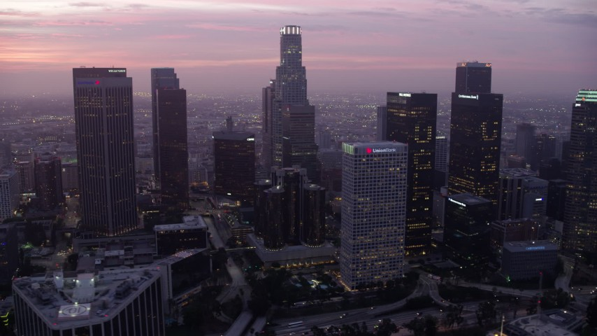 8K stock footage aerial video of towering skyscrapers around the Westin Bonaventure Hotel in Downtown Los Angeles at sunrise, California Aerial Stock Footage | AX0156_055
