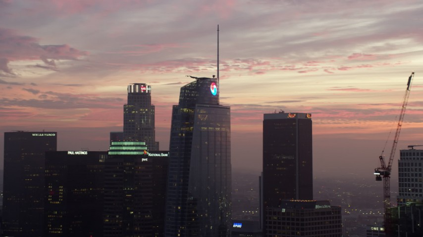 8K stock footage aerial video of the top of Wilshire Grand Center in Downtown Los Angeles at sunrise, California Aerial Stock Footage | AX0156_056