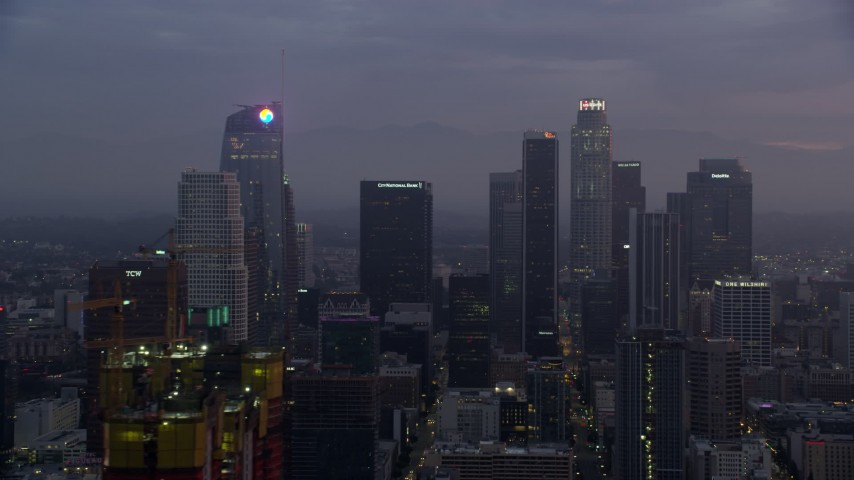8K stock footage aerial video of giant skyscrapers in Downtown Los Angeles at sunrise, California Aerial Stock Footage | AX0156_058