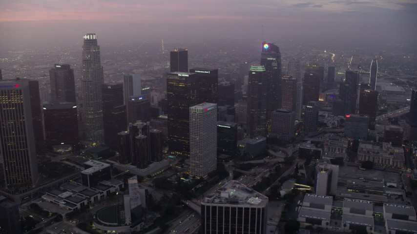 8K stock footage aerial video of tall skyscrapers around the Westin Bonaventure in Downtown Los Angeles at sunrise, California Aerial Stock Footage | AX0156_062