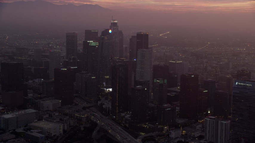 8K stock footage aerial video of Downtown Los Angeles, California as the sun rises, and reveal The Ritz-Carlton Aerial Stock Footage | AX0156_064