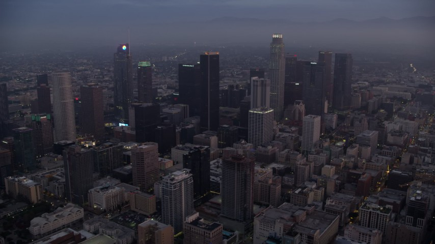 8K stock footage aerial video of the towering skyscrapers of Downtown Los Angeles, California as the sun rises Aerial Stock Footage | AX0156_066