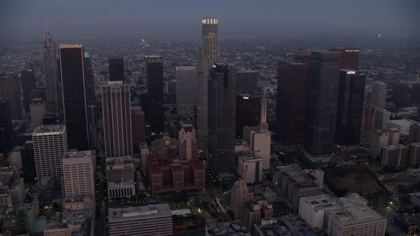 8K stock footage aerial video of the towering skyscrapers of Downtown Los Angeles, California early in the morning Aerial Stock Footage | AX0156_067