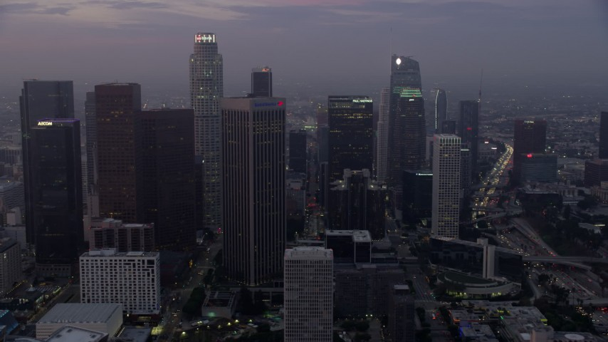 8K stock footage aerial video of skyscrapers around the Westin Bonaventure Hotel in Downtown Los Angeles, California early in the morning Aerial Stock Footage | AX0156_069