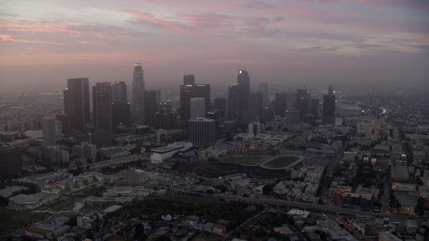 8K stock footage aerial video of a reverse view of Downtown Los Angeles, California on a hazy morning Aerial Stock Footage | AX0156_070