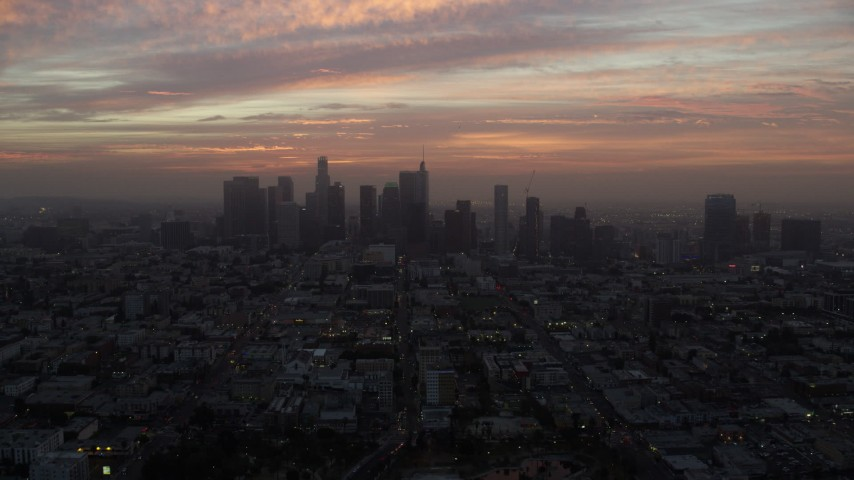 8K aerial video of golden clouds above Downtown Los Angeles skyline, California early in the morning Aerial Stock Footage | AX0156_072