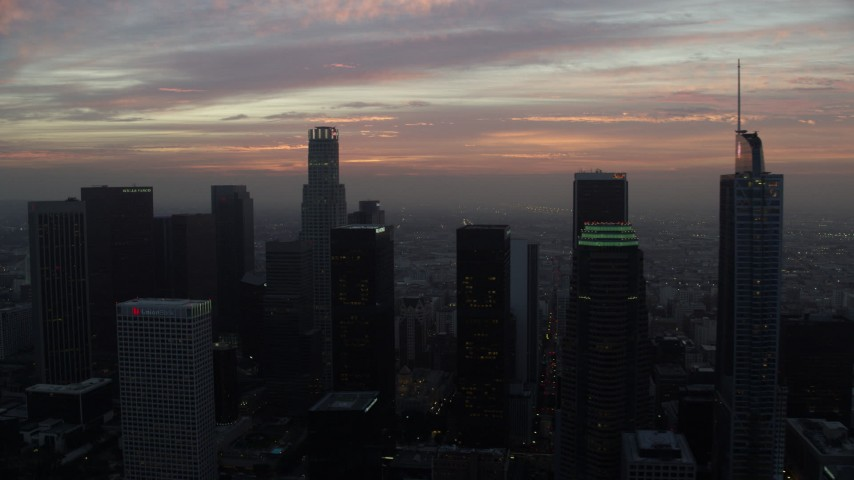 8K stock footage aerial video approaching US Bank Tower and high-rise buildings in Downtown Los Angeles, California early in the morning Aerial Stock Footage | AX0156_074