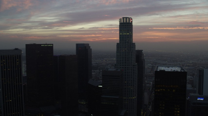 8K stock footage aerial video flying between skyscrapers in Downtown Los Angeles, California, revealing City Hall early in the morning Aerial Stock Footage | AX0156_075