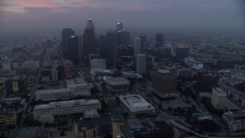 8K stock footage aerial video flying by City Hall with a view of skyscrapers in Downtown Los Angeles, California, early in the morning Aerial Stock Footage | AX0156_077