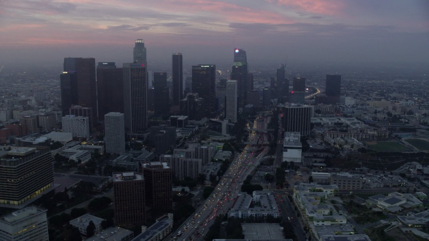 8K stock footage aerial video of skyscrapers and heavy morning commute traffic on 110 freeway in Downtown Los Angeles, California Aerial Stock Footage | AX0156_078