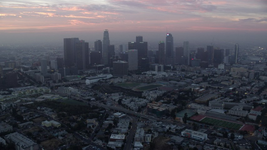 8K stock footage aerial video flying away from the Downtown Los Angeles, California skyline in the morning Aerial Stock Footage AX0156_079 | Axiom Images
