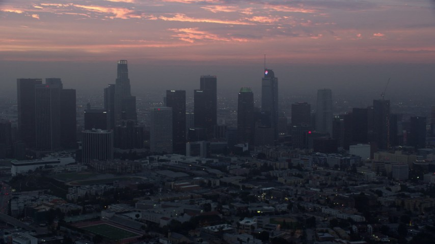8K aerial video of a reverse view of the Downtown Los Angeles, California skyline in the morning Aerial Stock Footage | AX0156_080