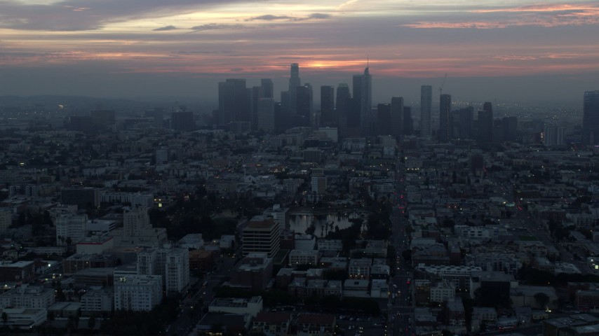 8K stock footage aerial video of an approach to MacArthur Park and the Downtown Los Angeles, California skyline on a hazy morning Aerial Stock Footage | AX0156_083