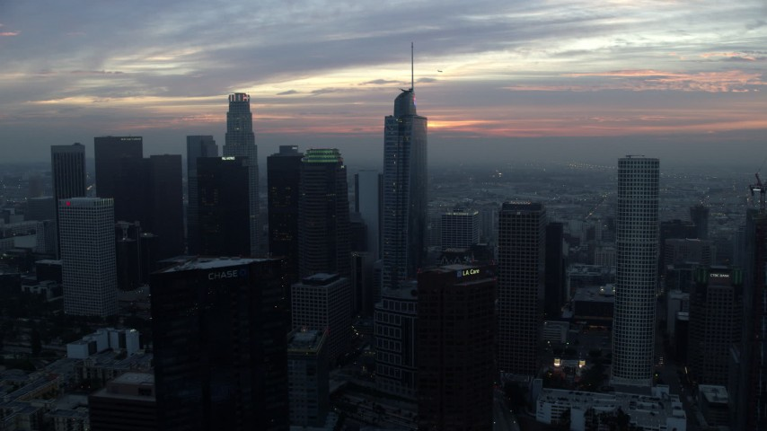 8K stock footage aerial video approaching Downtown Los Angeles, California skyline and Wilshire Grand Center tower on a hazy morning Aerial Stock Footage | AX0156_085