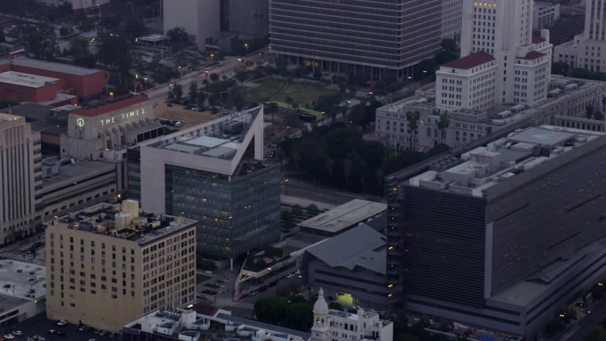 8K aerial video of LAPD Headquarters in Downtown Los Angeles, California at sunrise Aerial Stock Footage | AX0156_087