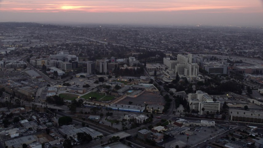 8K aerial video of the University of Southern California Health Sciences Campus in Boyle Heights, Los Angeles, California at sunrise Aerial Stock Footage | AX0156_090