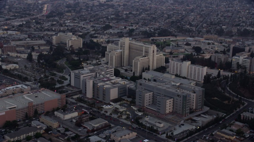 8K aerial video orbiting General Hospital at USC Health Sciences Campus in Boyle Heights, Los Angeles, California at sunrise Aerial Stock Footage | AX0156_093